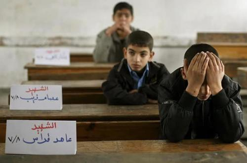 naasirheydari:</p><p>Empty seats in a Palestinian classroom. The signs name the children who were killed by Israel. </p><p>لا حول و لا قوة الا بالله<br />