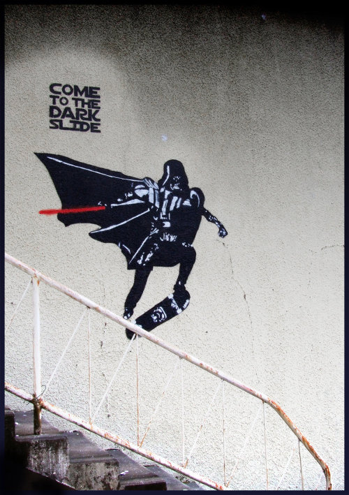 albotas:  Daily Graffiti: Come To The Dark Slide Everything about this skateboarding Darth Vader piece by blouharthur is freaking perfect. Gotta' love when street artists stragically juxtapose their pieces with real-world surroundings. Check out the Daily Graffiti Archives for more geektastic street art! Add your geeky graffiti pics to our Group Pool on Flickr! Buy: Wall and Piece by BanksyPeep it: More fresh Star Wars posts