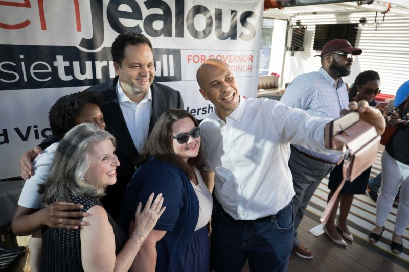 "Silver Spring, Md. - June 14: Candidate for Maryland Governor Ben Jealous, top center, is joined by Sen. Cory Booker, right, who takes a selfie with Jealous, candidate for Lt. Governor Susan Turnbull, Keila Foster and Cora Goecke, left to center, during a campaign event on the first day of Maryland early voting in Silver Spring, Md., on June 14, 2018. ""I'm a teacher, and the Maryland State Education Association supports him,"" said Foster. Jealous is a former national president and CEO of the NAACP. (Photo by Cheryl Diaz Meyer for The Washington Post via Getty Images)"