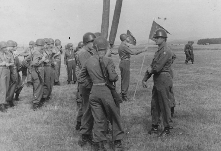 "85. Last minute instructions to color guards ""Must've been scratching a mosquito bite."" One dot over Capt Brener, two dots over Capt. Torres"