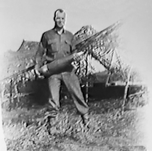 517. Battery A man with 95 lb. 155 mm round