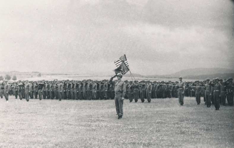 91. Passing in review parade day Cham Germany 1945 with rain is in the forecast