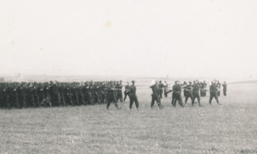 92. The 244th on parade field in the rain Cham Germany May 1945