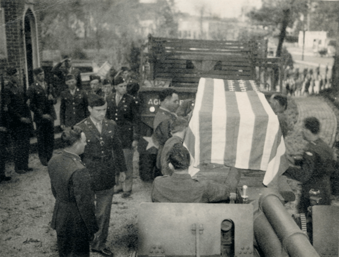 Funeral of Pvt. Joseph Creevey, Battery B 244th F.A.B. killed in the line of duty October 28, 1942 outside of the Hulett- Winstead Funeral Home