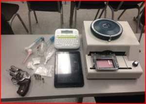 Stolen gun, drugs, a credit card machine,
