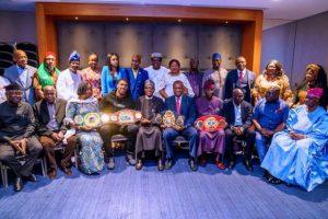 Anthony Joshua Prostrates as He Presents Heavyweight Titles to Buhari (Photos)