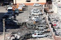 Damaged cars are seen after Friday's explosion outside a housing complex in the southeastern Turkish town of Viransehir in Sanliurfa province, Turkey, near the border with Syria.