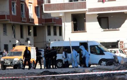 Forensics and police officers work on the blast scene after Friday's explosion outside a housing complex in the southeastern Turkish town of Viransehir in Sanliurfa province, Turkey, near the border with Syria.