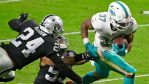 Dolphins' Myles Gaskin breaks two tackles for a...