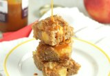 Caramel Apple Blondies (+ a VIDEO!) // 24 Carrot Life These fudgy Caramel Apple Blondies are the perfect holiday treat and you would never guess that they are made with healthy ingredients like whole wheat flour, almond meal, and coconut oil. I created a video to show you how easy it is to make these!