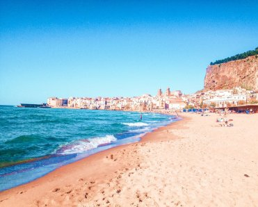 Cefalu beach Sicily living in palermo