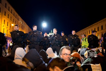 Munich citizens sat down on the route to block PEGIDA - Riot police force filming.