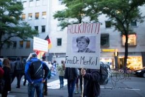 pegida 140915 2 - PEGIDA member demanding german chancellor Merkel to quit.