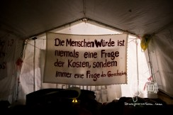 A banner inside the protest tent.