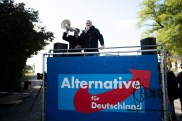 AfD functonaries hold speeches from a small stage.