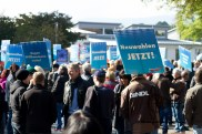 AfD demonstrators gather in Freilassing - sign demanding new elections to vote out chancellor Merkel.