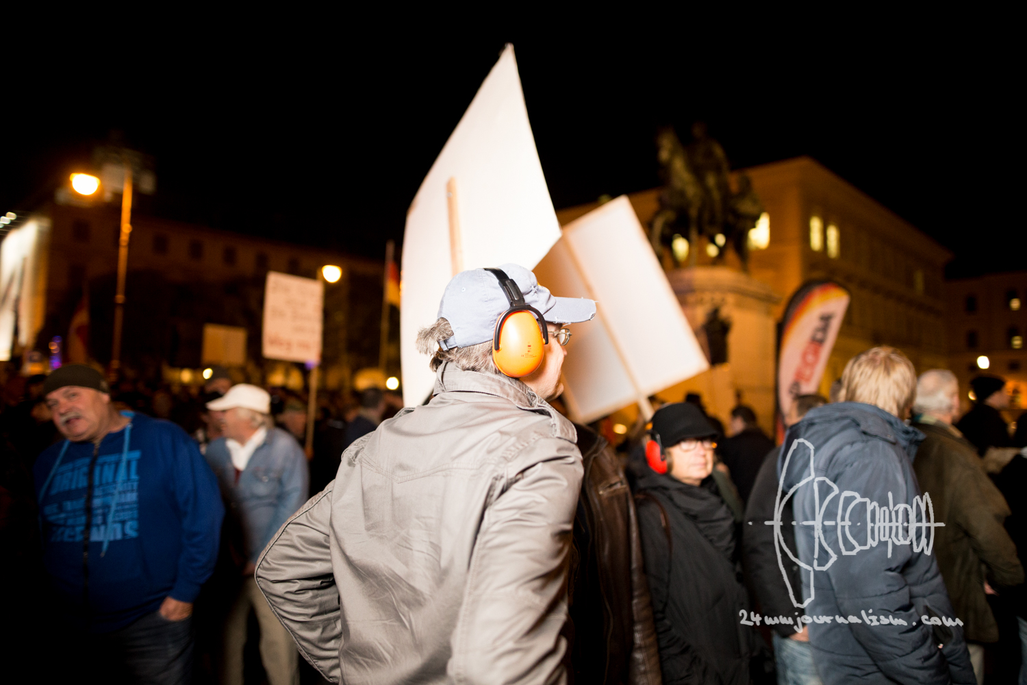PMEmber of PEGIDA wears ear protection.