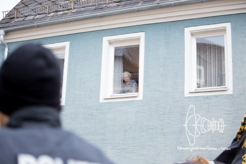 Wunsiedel citizen watches demonstration pass by