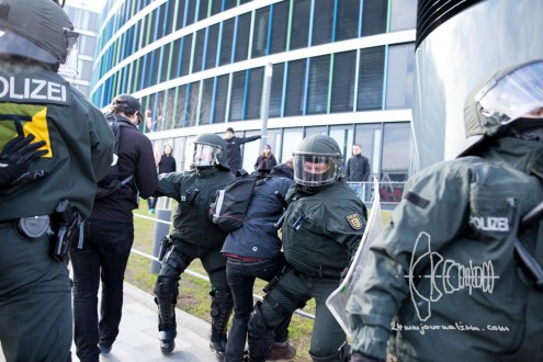 Police use force against counter demonstrators.