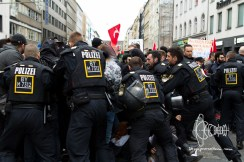 As the Turkish nationalists approach police violently pushes together antifacists.