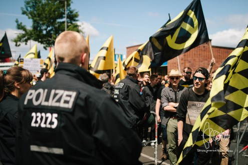 Participants wait to be controlled by police.