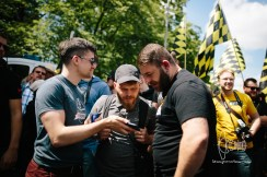 Martin Sellner shows other activists a video on smartphone