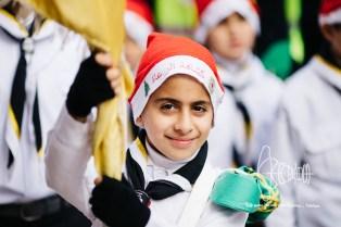 Boyscout with Santa hat.