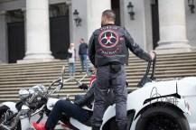 Turkos biker riding a trike standing.