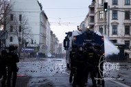 Water cannon fires on left activists.