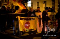 """REFUGEES NOT WELCOME"" flag next to PEGIDA fronttransparent"