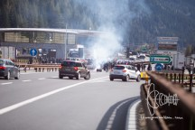 Activists block highway with fireworks and banners.