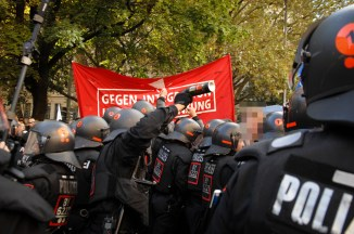 Policeman threatening rally with pepper spray. ©Robert Andreash