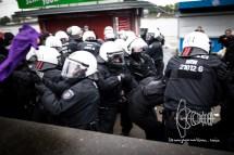 Arrest of a protestor at a roadblock.