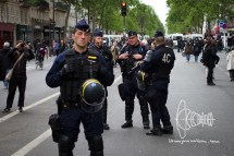 Heavy armed police watch the situation.