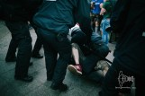 A police man tackles an attacker.