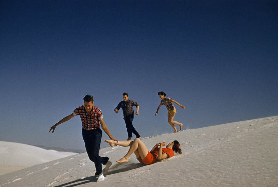 Teenagers run and play on large white sand dunes in New Mexico, 1957.Photograph by J. Baylor Roberts, National Geographic