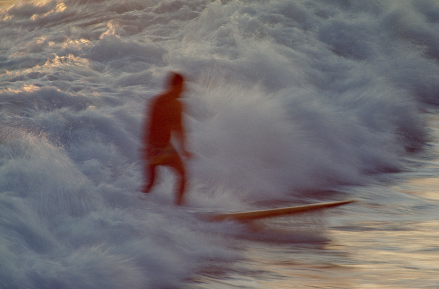 A surfer stands on a board in rough churning surf in Mazatlan, Mexico, August 1968.Photograph by W.E. Garrett, National Geographic