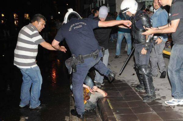Police beating a demonstrator in Besiktas (though the location is not confirmed)
