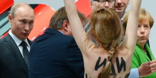 Angela Merkel and Vladimir Putin were confronted by a topless protester..  Not sure about Angela, but Vlad the Impaler surely was amused.. I'm sure KGB style research is being conducted to get a phone number as I type..