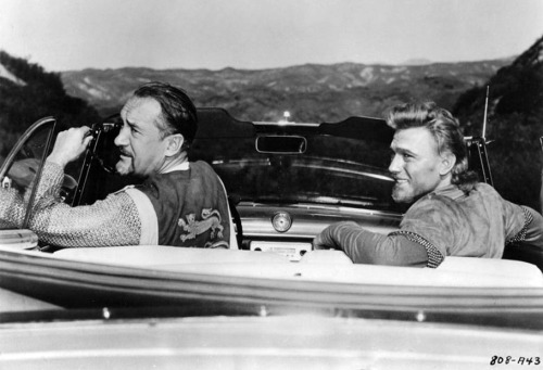 Stellar Vintage #238: In costume chain mail and surplice, George Sanders (in the role of King Richard) and Laurence Harvey (dressed for Sir Kenneth Huntington) leave production of King Richard and the Crusaders (1954) in a sleek convertible. Who needs a horse?