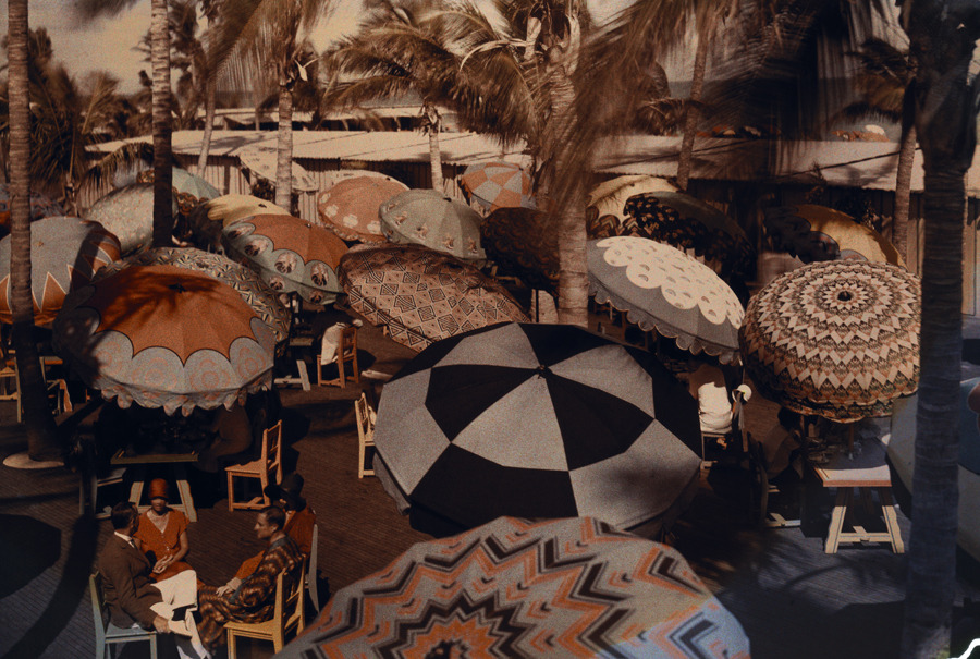 Club members on the ocean front are shaded by decorative parasols, 1930.Photograph by Clifton R. Adams, National Geographic