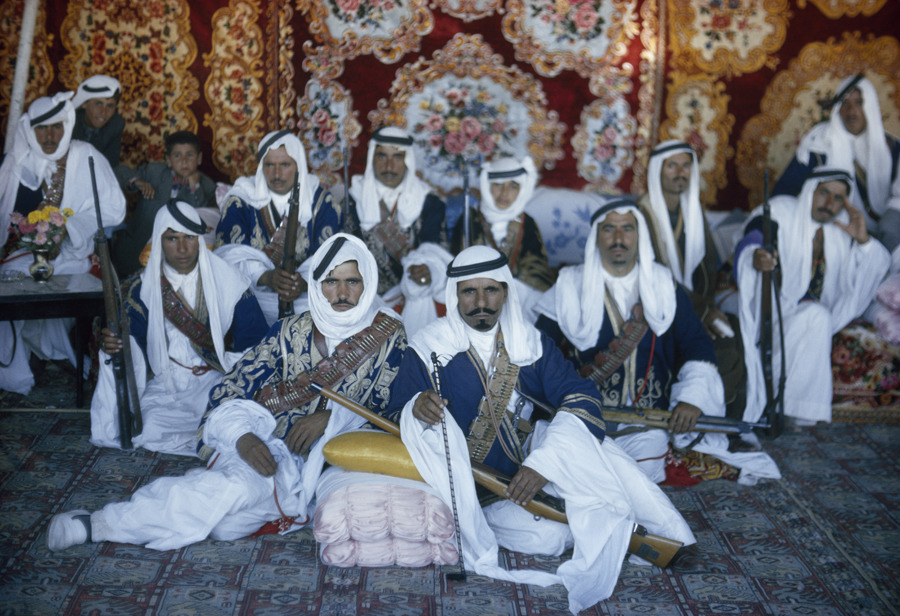 Armed Bedouin Beni Sakhr chiefs await their king's visit in Jordan, December 1964.Photograph by Luis Marden, National Geographic