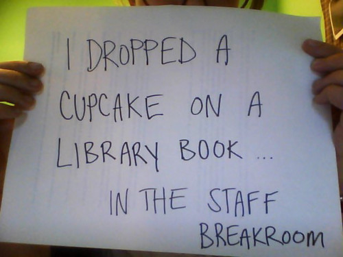 I dropped a cupcake on a library book… in the staff break room.