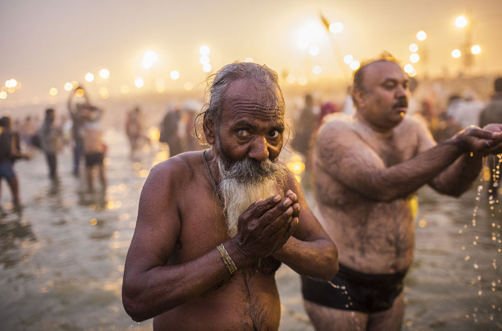 Hindu devotees bathe in the waters of the holy Ganges river during the Maha Kumbh Mela in Allahabad, on January 14, 2013.(Daniel Berehulak/Getty Images)