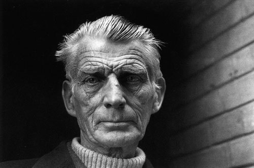 Samuel Beckett. Pictured leaving the Royal Court Theatre, Sloane Square, London, via the stage door, after rehearsals of Happy Days starring Billie Whitelaw, as part of the Beckett season to celebrate his 70th birthday. April 1976