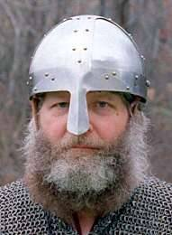 During the Viking era, helmets typically were made from several pieces of iron riveted together , called a spangenhelm style of helm. It's easier to make a helmet this way, requiring less labor, which may be why it was used.