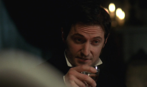 'Ugh, so difficult to drink things with this damn cravat on. Must take dainty sips.'