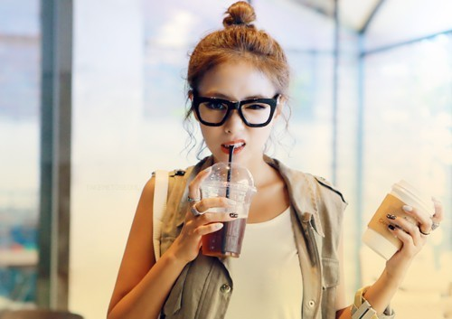 Girl holding two coffees