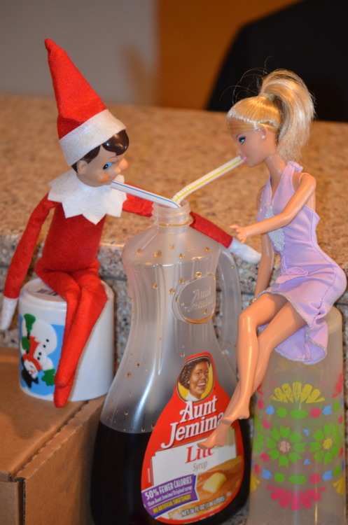 Sipping on Syzzrp Elf on the Shelf Clyde is always hitting on Barbie.