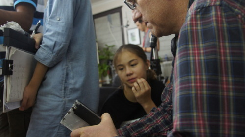 Lead Actress Sofie Fella, 12, speaks with director Richard Trombly on the set. Analysis http://www.obscure-productions.com/analysis.html  was shot on location in Shanghai China in August 2012.
